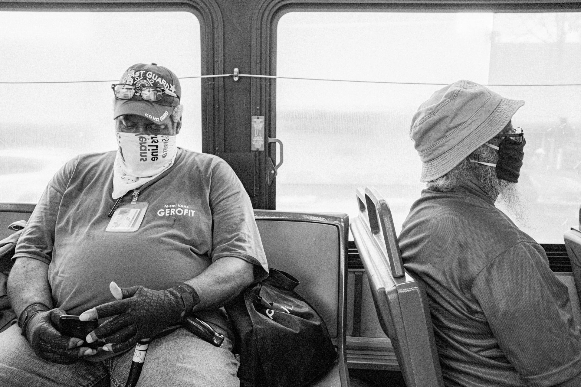 Transit riders wearing masks